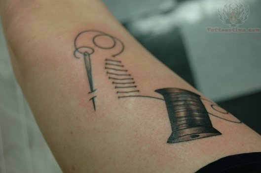 spool-and-needle-sewing-arm-tattoo
