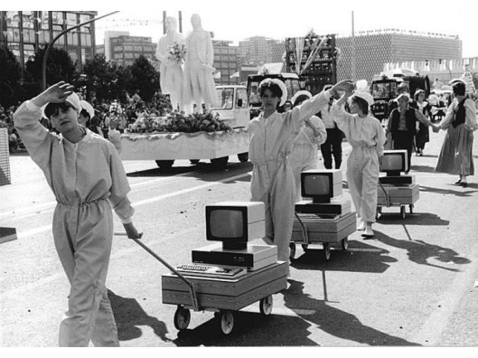 workers-demonstrate-computers-in-a-parade-of-1987-in-East-Germany
