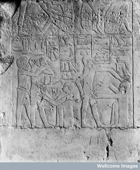 M0005235 Egypt, wall carving showing a circumcision scene, Sakkara