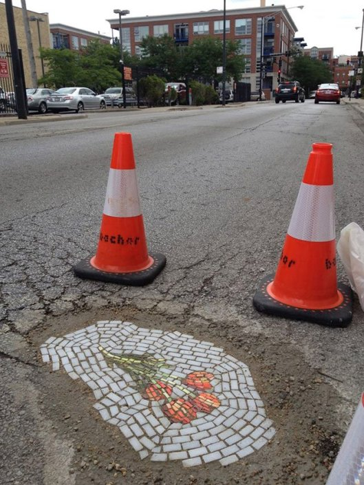 artist-bachor-fills-potholes-with-food-and-flower-mosaics-16