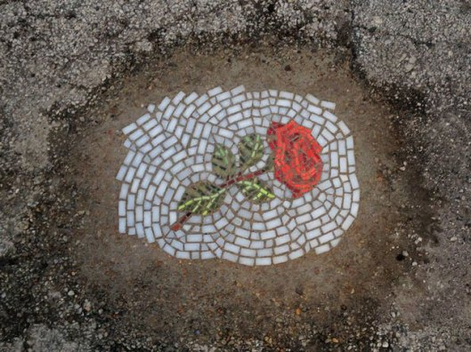 artist-bachor-fills-potholes-with-food-and-flower-mosaics-18
