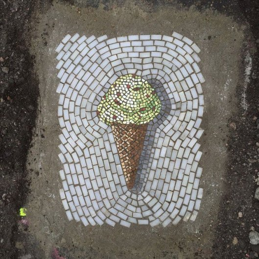 artist-bachor-fills-potholes-with-food-and-flower-mosaics-5