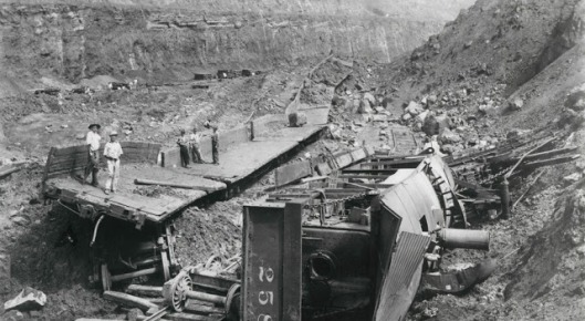 13. Workers standing near a landslide that destroyed digging machinery, during the construction of the Panama Canal at Culebra Cut in Panama, May 29, 1913