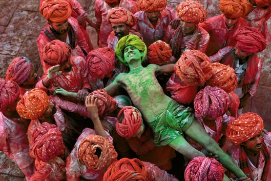 A crowd carries a man during the Holi festival in Rajasthan in 1996