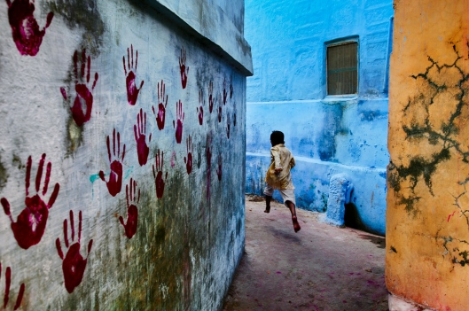 A boy in mid-flight in the Blue City, a small tightly knit maze of houses located towards the north of Jodhpur, Rajasthan, in 2007
