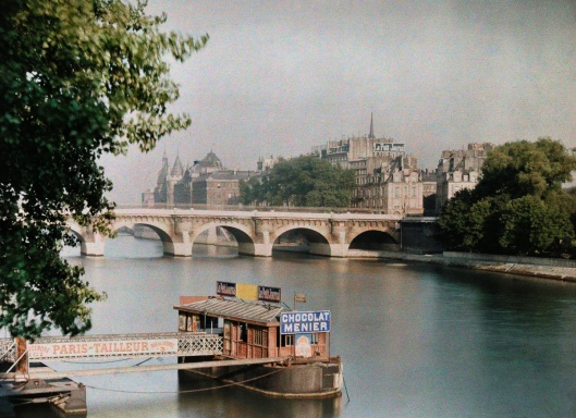 ca. January 1923, Paris, France --- A view of the river and a bridge --- Image by © Gervais Courtellemont/National Geographic Creative/Corbis