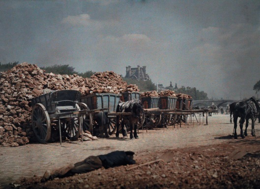 ca. January 1923, Paris, France --- Carts piled with rubble and person lying down on the ground --- Image by © Gervais Courtellemont/National Geographic Creative/Corbis