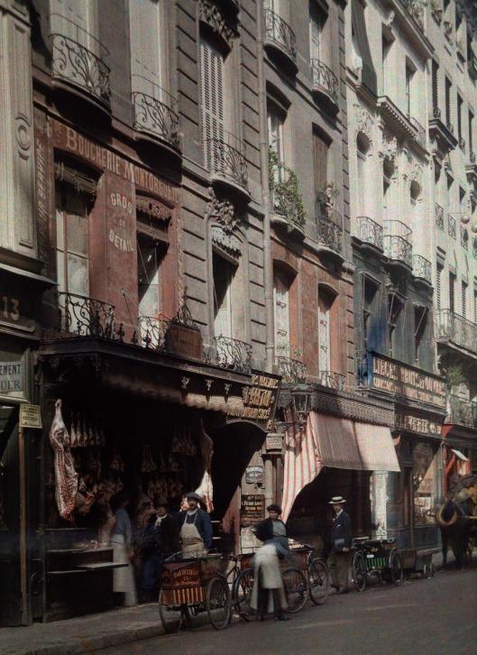 ca. January 1923, Paris, France --- A street scene in Paris --- Image by © Gervais Courtellemont/National Geographic Creative/Corbis